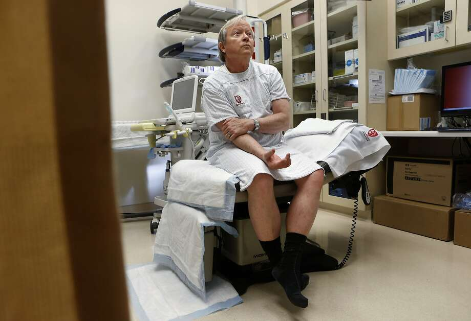 Bill Robnett of Monterey waits for oncologist Dr. Geoff Sonn as he prepares to have biopsies of his prostate at Palo Alto's Stanford Cancer Center, where doctors are also using a new machine to help spot potential cancerous tumors. Photo: Michael Macor, The Chronicle
