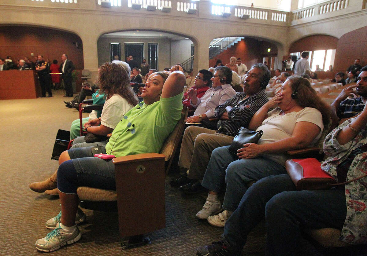 Residents hear the vote, 6-4, passing the measure to change their neighborhood as District 3 residents listen to city council vote on the rezoning of Mission Trails Mobile Home Park on May 15, 2014.