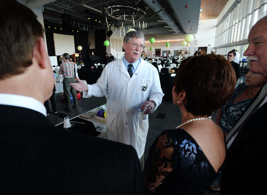 Michael Hoke explains the uses and the science behind superconductors during Thursday evening's gala. The Event Centre hosted the Super Scientific Gala on Thursday evening to benefit the Beaumont Children's Museum. The event included a catered dinner, drinks, telescopes for stargazing, and a slew of science experiments that mirrored what the museum hopes to provide children.  Photo taken Thursday 5/15/14 Jake Daniels/@JakeD_in_SETX Photo: Jake Daniels / ©2014 The Beaumont Enterprise/Jake Daniels