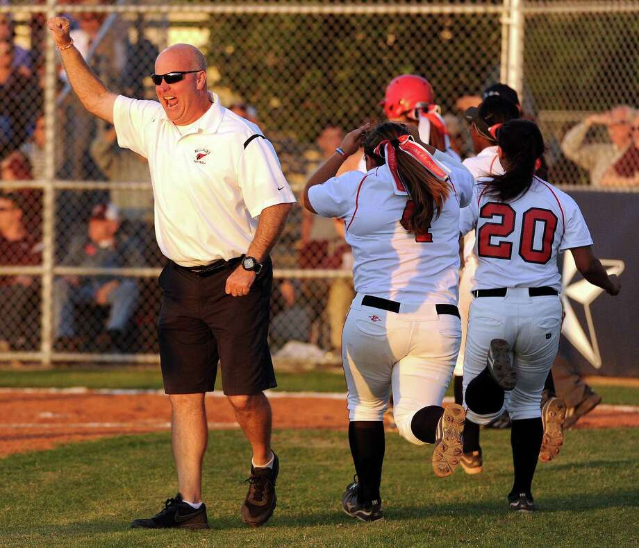 Bellaire head coach Brien Tuffly celebrates Haleigh Davis's grand slam during the third inning of a high school softball playoff game against Pearland, Thursday, May 15, 2014, at Baytown Sterling High School in Baytown. Photo: Eric Christian Smith, For The Chronicle