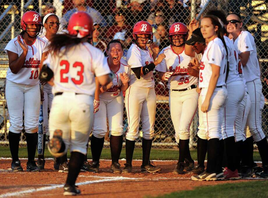 The Bellaire Lady Cardinals cheer Haleigh Davis (23) at home plate after Davis' grand slam in the third inning of a high school softball playoff game against Pearland, Thursday, May 15, 2014, at Baytown Sterling High School in Baytown. Photo: Eric Christian Smith, For The Chronicle