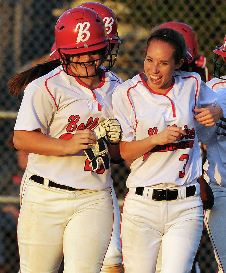 Bellaire's Haleigh Davis, left, celebrates her grand slam with Kaelyn Kringle in the third inning of a high school softball playoff game against Pearland, Thursday, May 15, 2014, at Baytown Sterling High School in Baytown. Photo: Eric Christian Smith, For The Chronicle