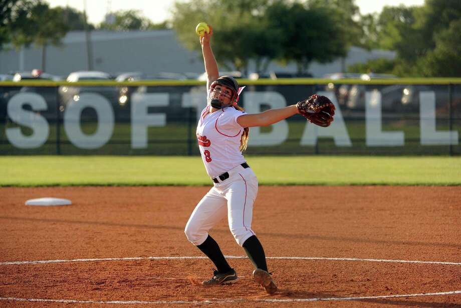 Bellaire's Gabriela Alatorre delivers a pitch during the first inning of a high school softball playoff game against Pearland, Thursday, May 15, 2014, at Baytown Sterling High School in Baytown. Photo: Eric Christian Smith, For The Chronicle