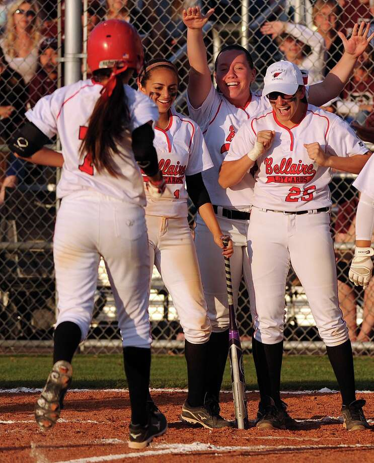 Bellaire's Molly Oretsky (25) and teamates cheer Elizabeth Castillo's, left, solo home run at home plate during the second inning of a high school softball playoff game against Pearland, Thursday, May 15, 2014, at Baytown Sterling High School in Baytown. Photo: Eric Christian Smith, For The Chronicle