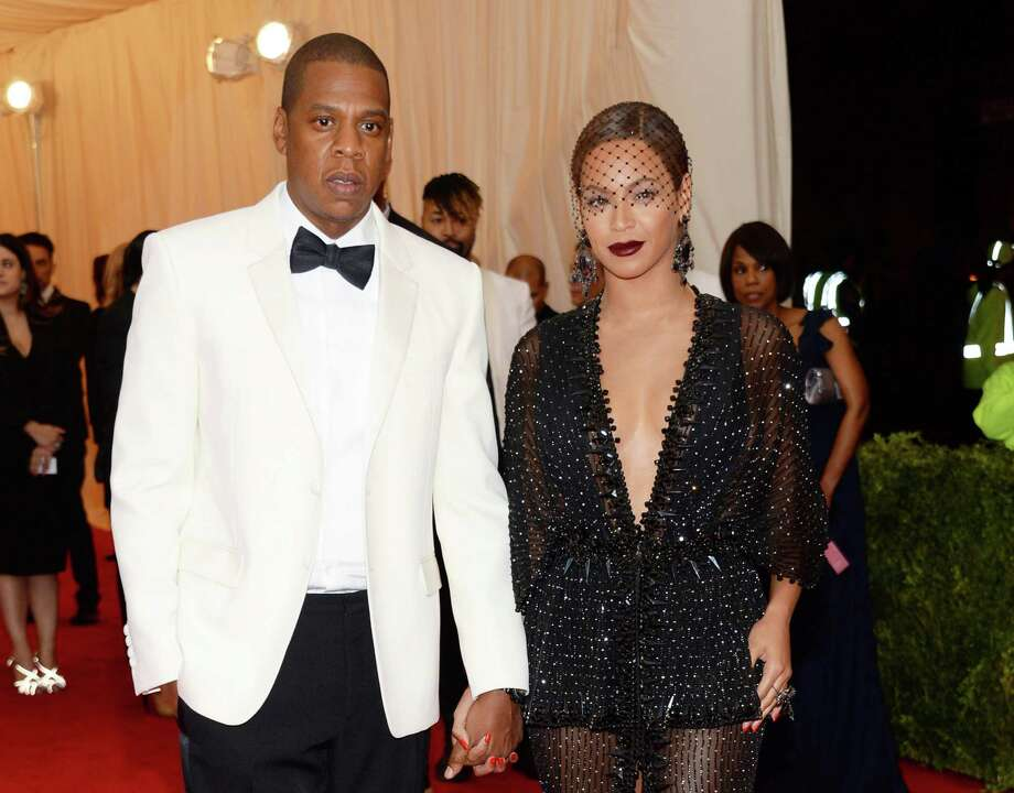 "FILE - This May 5, 2014 file photo shows Jay Z, left, and Beyonce at The Metropolitan Museum of Art's Costume Institute benefit gala celebrating ""Charles James: Beyond Fashion"" in New York. Beyonce, Jay Z and Solange say they have worked through and are moving on since a video leaked this week of Solange attacking Jay Z in an elevator inside the Standard Hotel after the May 5, gala. (Photo by Evan Agostini/Invision/AP, File) ORG XMIT: NYET423 Photo: Evan Agostini / Invision"
