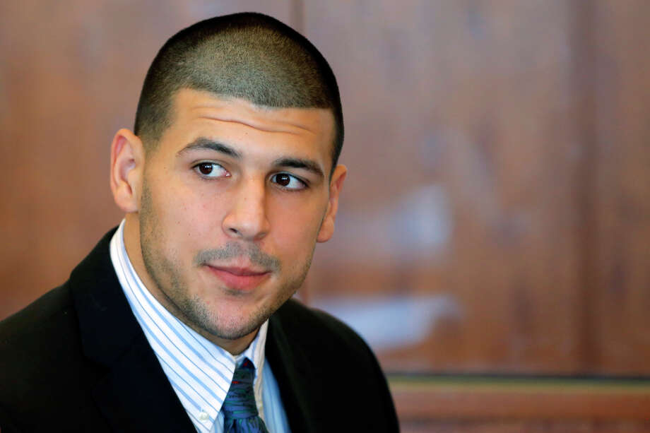 FILE - In this Oct. 9, 2013 file photo, former New England Patriots NFL football player Aaron Hernandez attends a pretrial court hearing in superior court in Fall River, Mass. Hernandez, who already faces a murder charge in a man's shooting death last year, was indicted Thursday, May 15, 2014, on new murder charges in an unrelated 2012 double slaying in Boston, police said. (AP Photo/Brian Snyder, Pool, File) Photo: Brian Snyder, POOL / Pool Reuters
