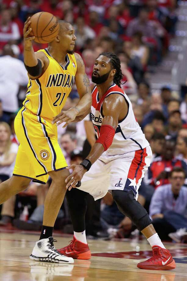 Indiana Pacers forward David West (21) passes around Washington Wizards forward Nene during the first half in Game 6 of an Eastern Conference semifinal NBA basketball playoff series in Washington, Thursday, May 15, 2014. (AP Photo/Alex Brandon) ORG XMIT: VZN108 Photo: Alex Brandon / AP