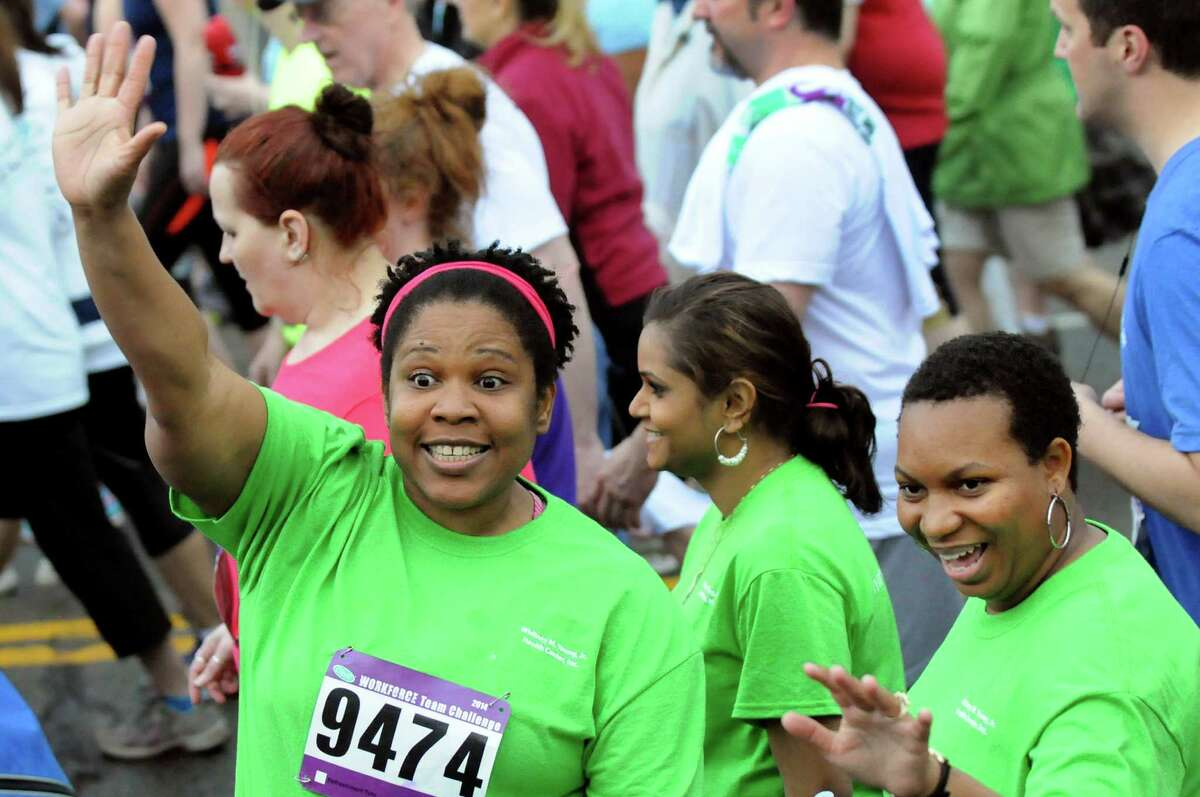 Roxanna Francis of Whitney M. Young Jr. Health Center, left, waves to a friend at the start of the CDPHP Workforce Team Challenge on Thursday, May 15, 2014, in Albany, N.Y. (Cindy Schultz / Times Union)