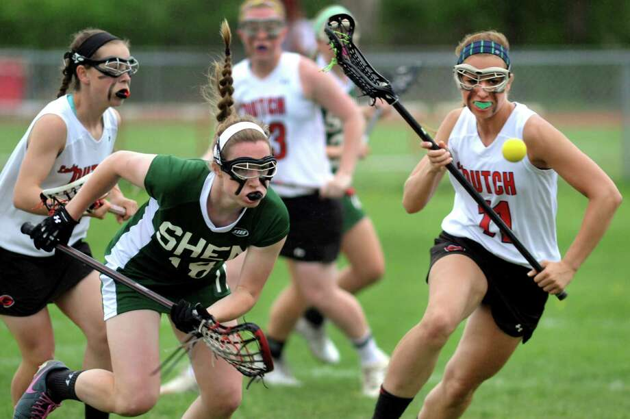 Guilderland's Michelle Burmistrova, right, and Shen's Meghan Pendergast, center, chase a loose ball during their Class A lacrosse semifinal game on Thursday, May 15, 2014, at Guilderland High in Guilderland, N.Y. (Cindy Schultz / Times Union) Photo: Cindy Schultz / 00026893A
