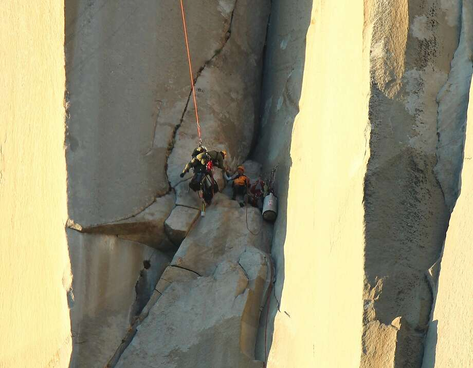 A rescue specialist, lowered by rope from a helicopter, reaches a climber who was injured in a fall while scaling the Nose Route of Yosemite's El Capitan in September 2011. Photo: Nps, NPS