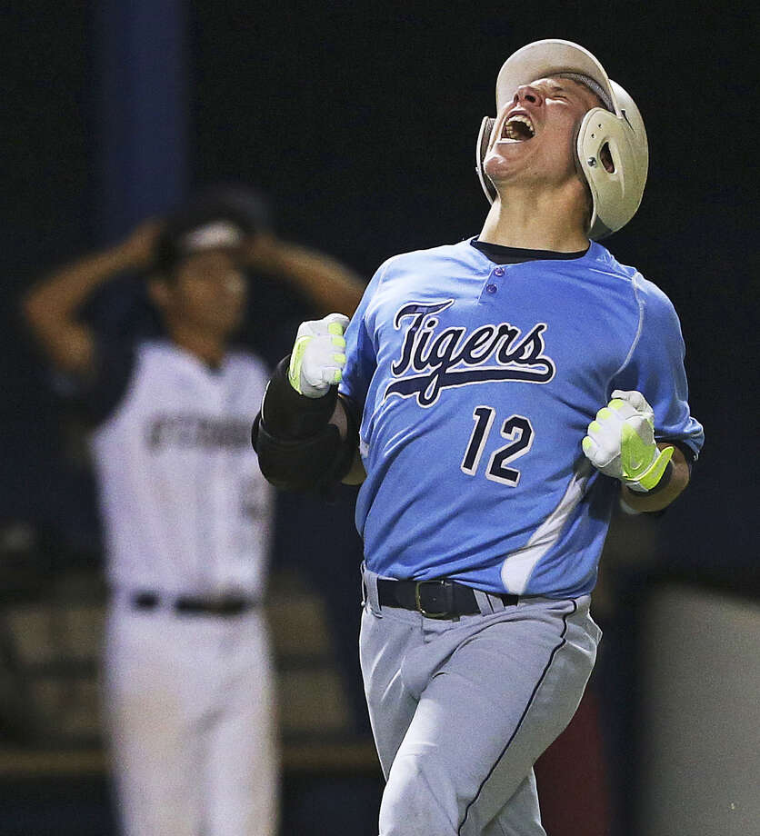 Carroll's Trace Bucey exults during the No. 2 Tigers' 7-1 win over top-ranked O'Connor in a 5A showdown. Photo: Tom Reel / San Antonio Express-News