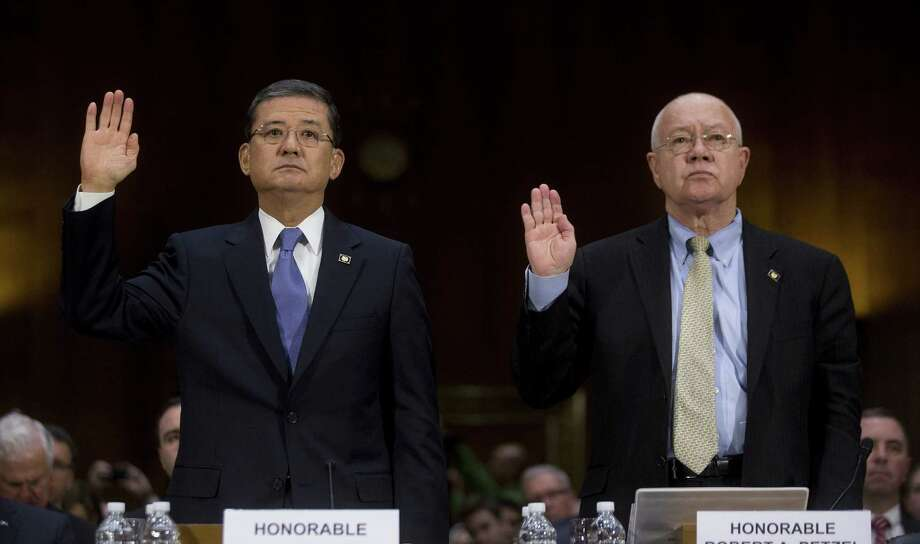 Veterans Affairs Secretary Eric Shinseki (left) and Robert Petzel, the VA's undersecretary for health, swear in at a Senate hearing. Photo: Andrew Harrer / Bloomberg / © 2014 Bloomberg Finance LP
