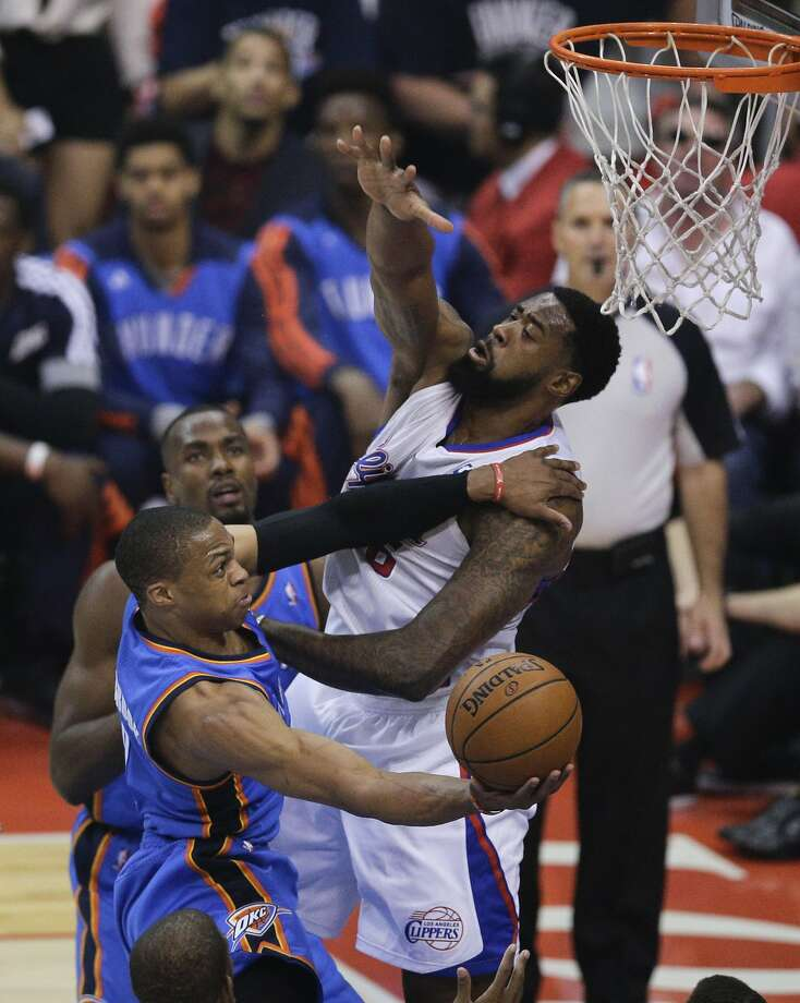 The Thunder's Russell Westbrook uses both hands to get his shot up against Clippers' center DeAndre Jordan. Photo: Jae C. Hong, Associated Press