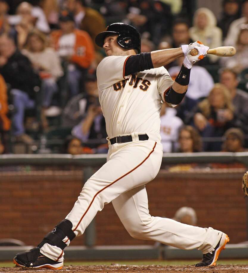 San Francisco Giants' Buster Posey hits a two RBI double against the Miami Marlins during the fifth inning of a baseball game, Thursday, May 15, 2014, in San Francisco.  Photo: George Nikitin, Associated Press