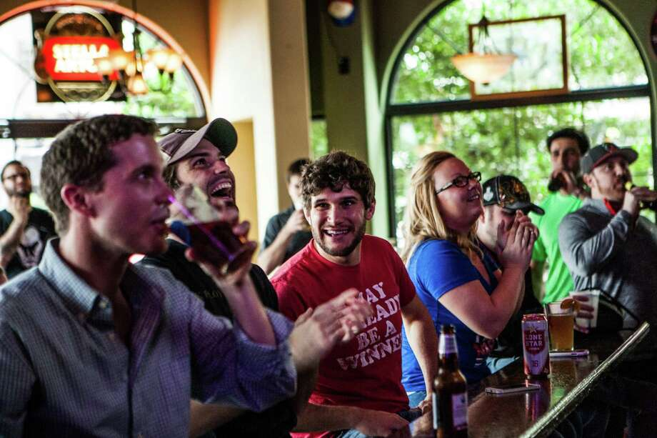 George Huber laughs with Daniel Cohen after a goal by the New York Rangers at The Maple Leaf Pub Tuesday May 13, 2014. The Maple Leaf Pub has a large number of customers who flock to the bar to watch hockey. Photo: Michael Starghill, Jr., For The Chronicle / © 2014 Michael Starghill, Jr.