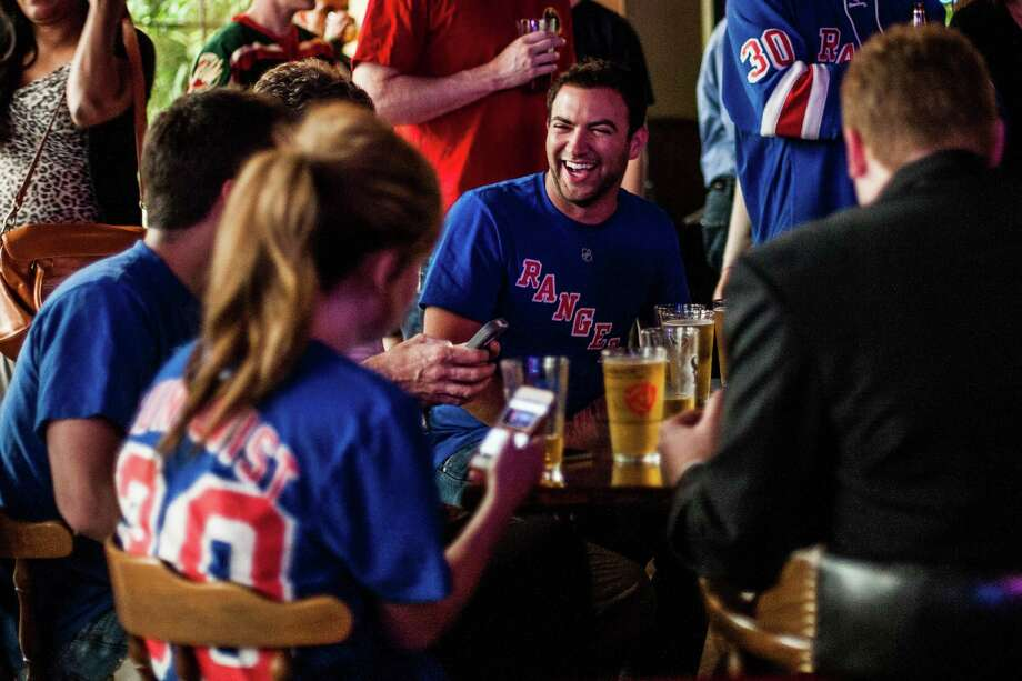 Matt Cohen, a Brooklyn native and Heights resident, laughs with his fellow New York Ranger fans at The Maple Leaf Pub Tuesday May 13, 2014. The Maple Leaf Pub has a large number of customers who flock to the bar to watch hockey. Photo: Michael Starghill, Jr., For The Chronicle / © 2014 Michael Starghill, Jr.