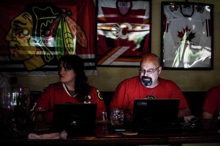 Natalie Wooten and Doug Cerny wait for the Chicago Blackhawks game to start at The Maple Leaf Pub Tuesday May 13, 2014. The Maple Leaf Pub has a large number of customers who flock to the bar to watch hockey. Photo: Michael Starghill, Jr., For The Chronicle / © 2014 Michael Starghill, Jr.