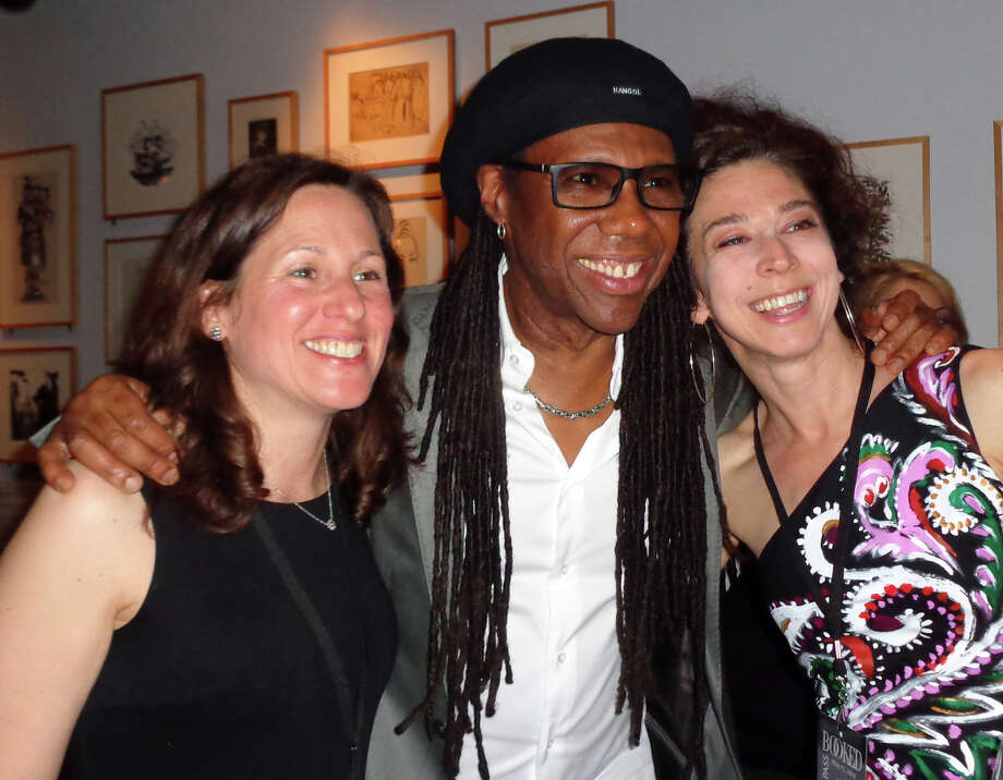 "Grammy Award-winning musician, songwriter and producer Nile Rodgers of Westport took time to pose for photos and autograph copies of his book ""Le Freak: An Upside Down Story of Family, Disco and Destiny"" at the Westport Library Thursday before moving upstairs to the Great Hall where he was honored at the 16th annual ""BOOKED for the Evening"" event. Here, he poses with Suzanne Leopold, left, and Sooo-z Mastropietro, both of Westport Photo: Meg Barone / Westport News"
