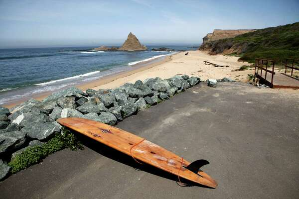 A surfboard belonging to Danson Drummer of Mill Valley rests on the ground at Martin's Beach in Half Moon Bay, CA, Thursday May 15, 2014.