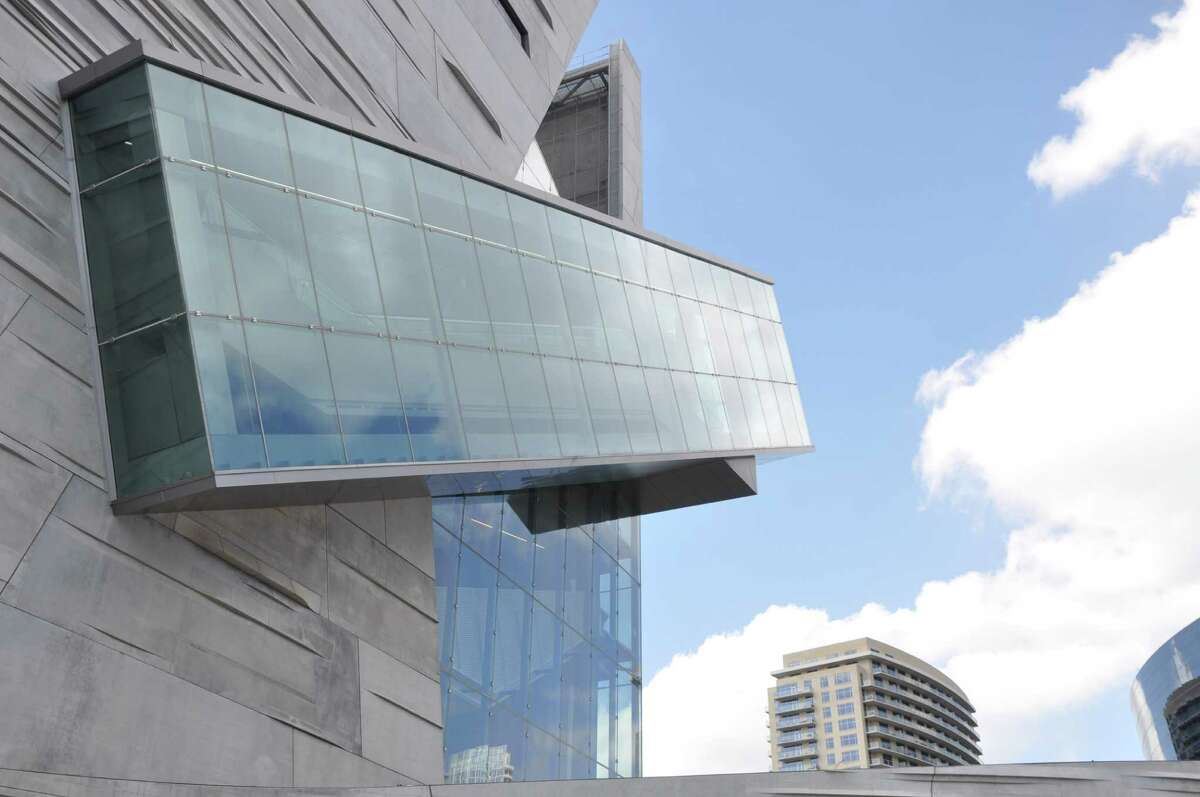 """The Perot Museum of Nature and Science in Dallas, Texas, has the summer blockbuster exhibit, """"The World's Largest Dinosaurs."""" The museum was designed by Pritzker Architecture Prize Laureate Thom Mayne and his firm Morphosis Architects."""