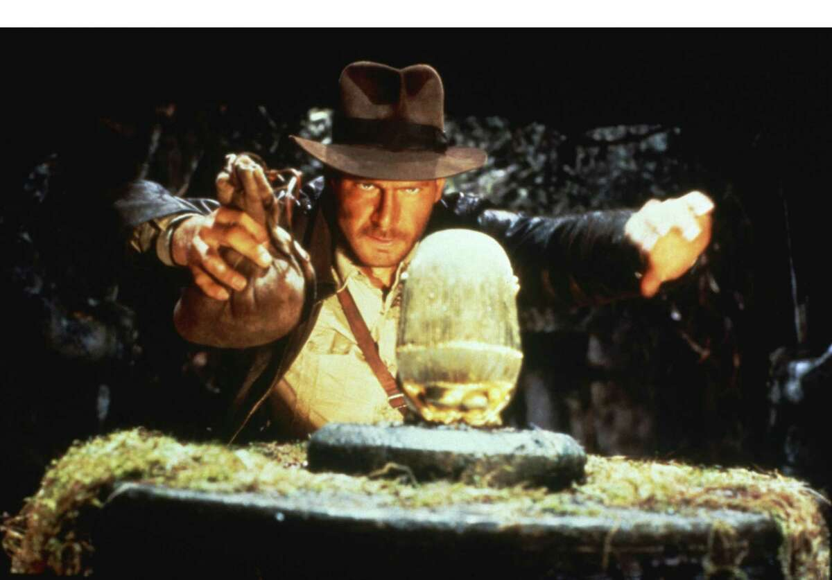 """The """"Indiana Jones and the Adventure of Archaeology"""" exhibit at the Forth Worth Museum of Science and History mixes film props and clips with real-life artifacts."""