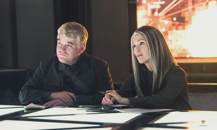 Plutarch Heavensbee (the late Philip Seymour Hoffman) and President Alma Coin (Julianne Moore). Photo: Lionsgate