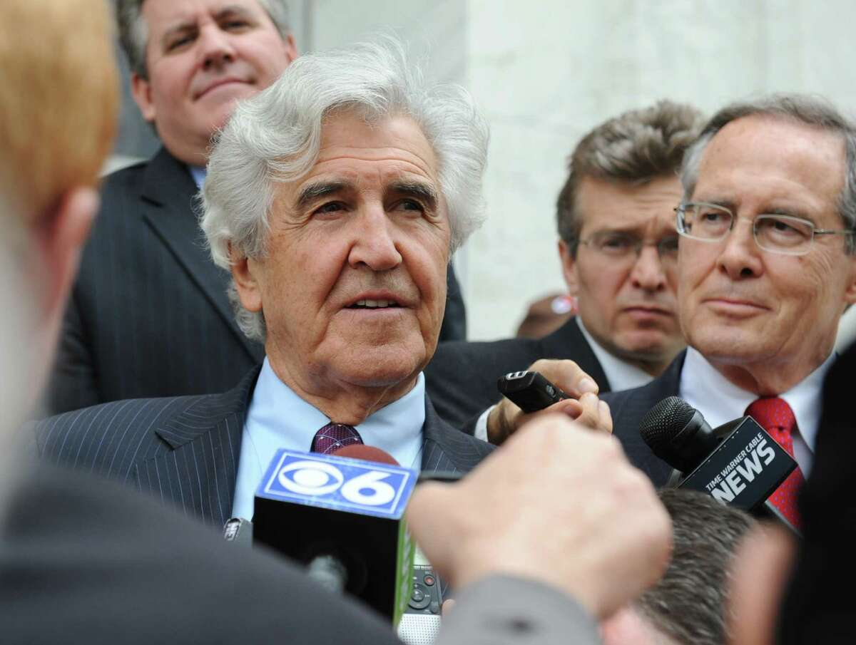 Former State Senate Majority Leader Joseph Bruno talks to the media as he leaves the James T. Foley U.S. Courthouse following Bruno's not guilty verdict on federal corruption charges Friday, May 16, 2014, in Albany, N.Y. The couple were headed to Jack's to celebrate. (Lori Van Buren / Times Union)
