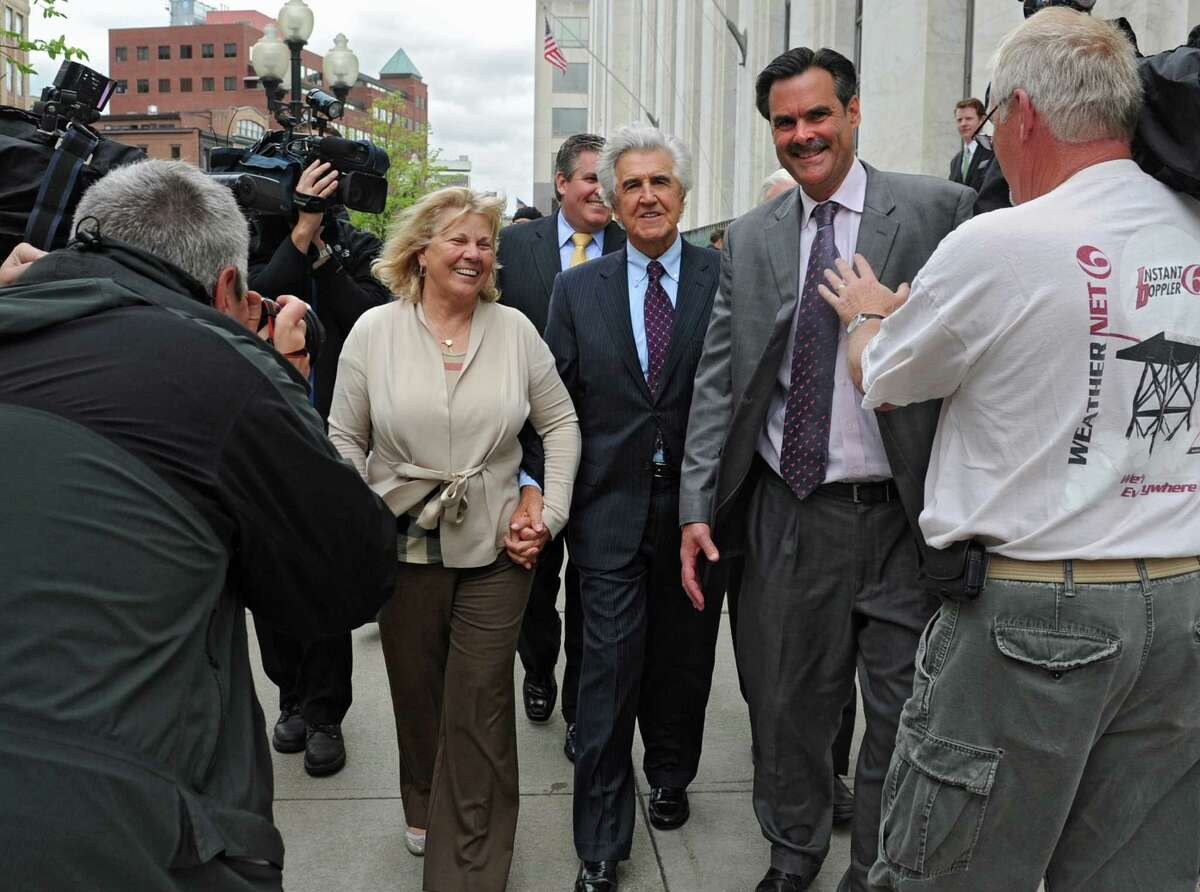 Former State Senate Majority Leader Joseph Bruno leaves the James T. Foley U.S. Courthouse holding hands with girlfriend Kay Stafford following Bruno's not guilty verdict on federal corruption charges Friday, May 16, 2014, in Albany, N.Y. The couple were headed to Jack's to celebrate. (Lori Van Buren / Times Union)