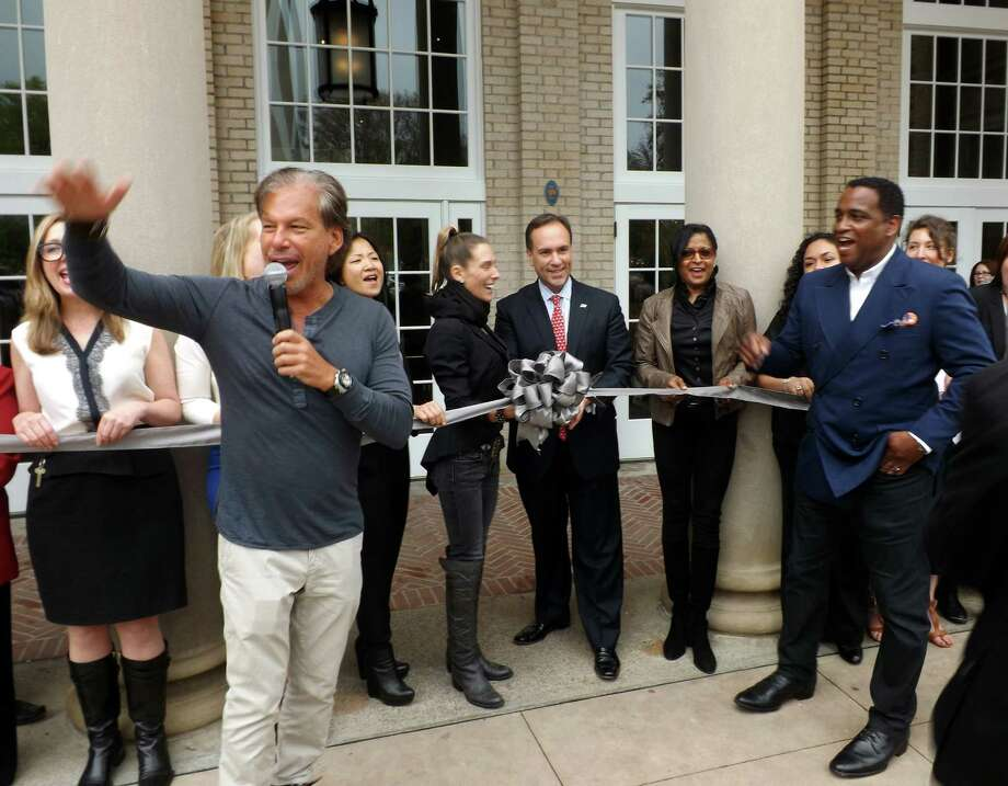 Restoration Hardware Chairman and CEO Gary Friedman and Hardware Senior VP of Retail Stores and Chief Value Officer DeMonty Price speak at the ribbon cutting ceremony for the newly opened RH Design Gallery on Friday, May 16, 2014. Restoration Hardware's new store is in the former U.S. Post Office on Greenwich Ave. in Greenwich, Conn. Also taking part in the celebration, Greenwich First Selectman Peter Tesei and Greenwich resident and building owner (through Greenwich Retail LLC) Peter Malkin. Photo: Tim Loh / Greenwich Time