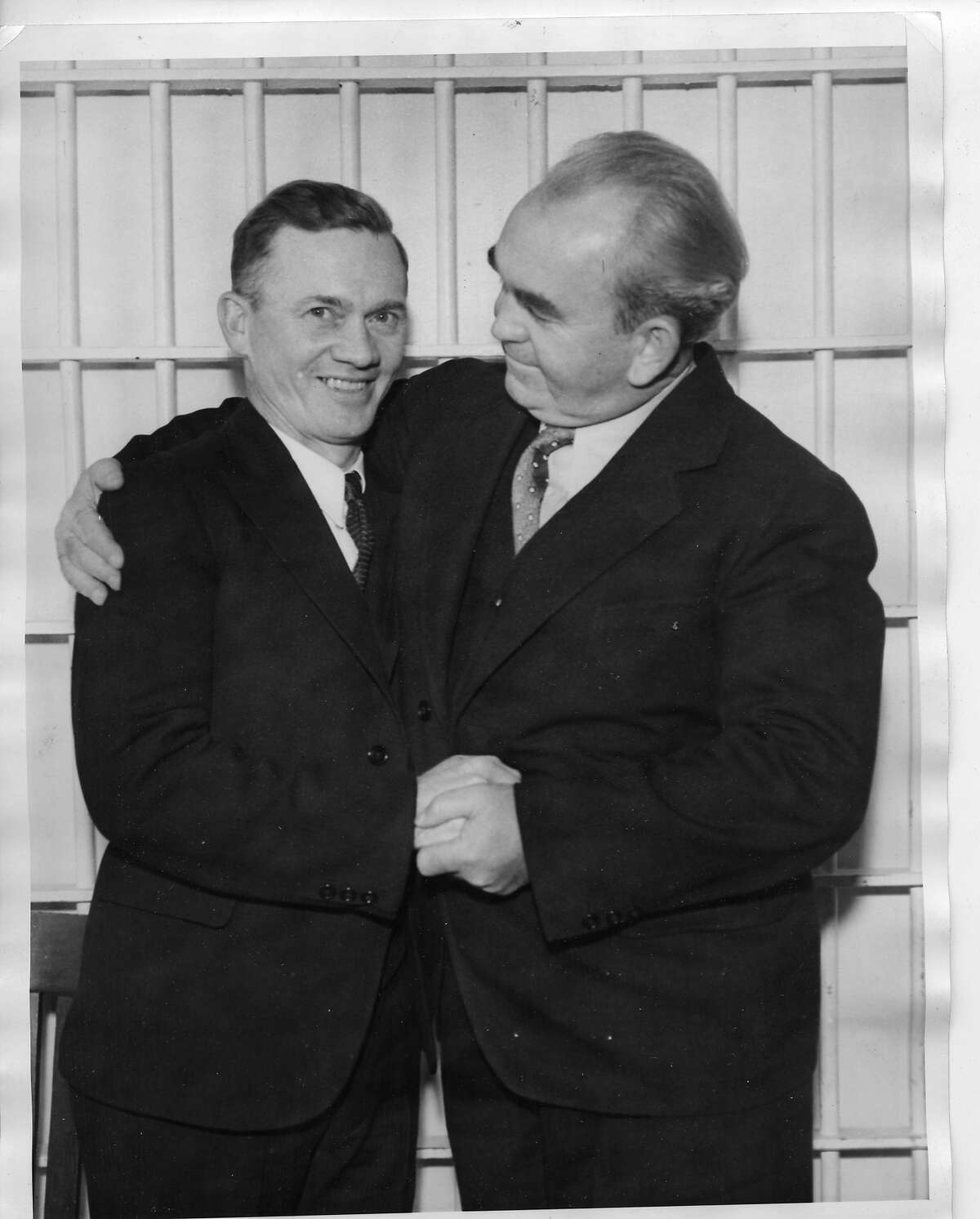 Warred Billings (left) meet in Tom Mooney's cell. It was their first meeting since the trial 18 years before. They are attending the Mooney Habeas Corpus hearing. The prison was Mooney's home for more than 22 years. He was convicted and sentenced to death for the 1916 Preparedness Day Parade bombing. His sentence was later commuted to life imprisonment. Associated Press Photo .. date on back may be Sept. 25 1935
