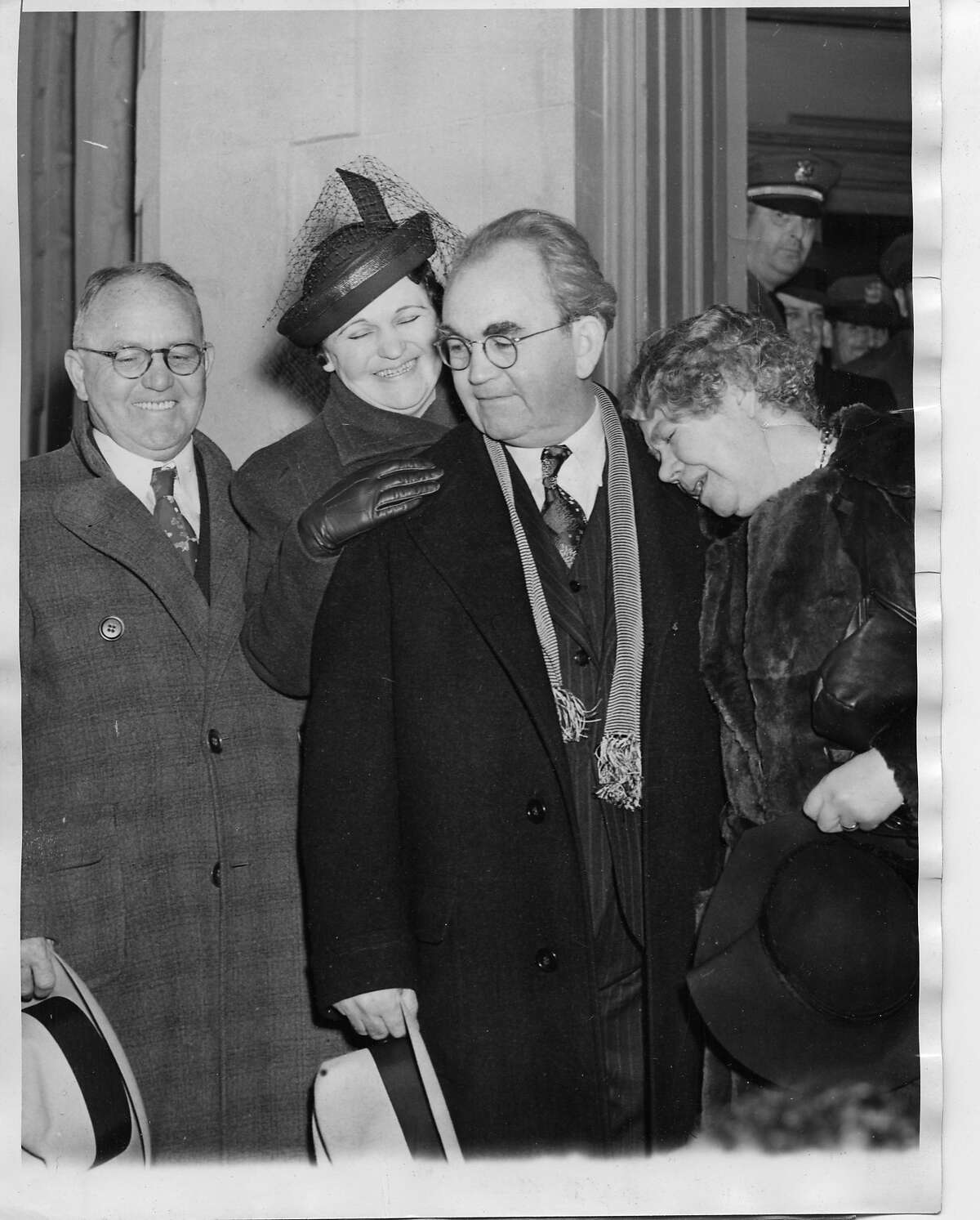 Tom Mooney was greeted by his brother John, left, his sister Anna Mooney, and, Rena Mooney , sobbing. when he left San Quentin Prison 1/7/1939. The prison was Mooney's home for more than 22 years. He was convicted and sentenced to death for the 1916 Preparedness Day Parade bombing. His sentence was later commuted to life imprisonment. Associated Press Photo dated 1/01/39