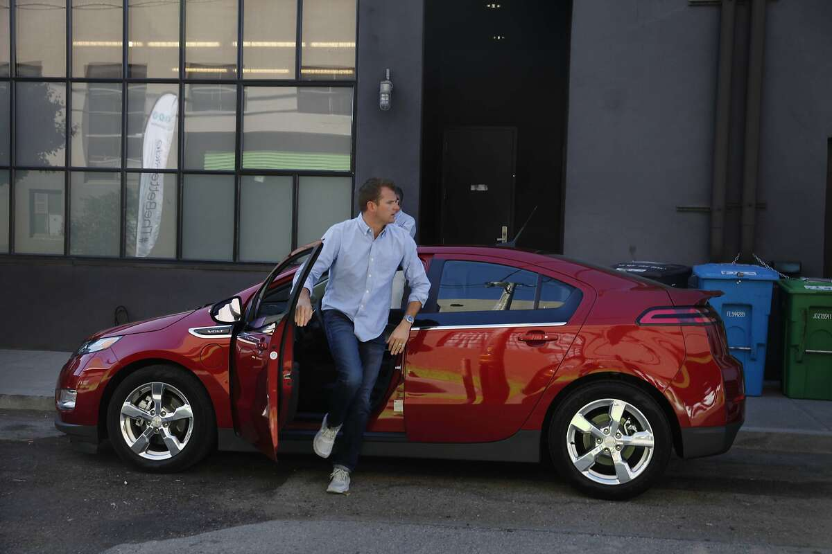 Seth Nenaber, Jack Morton account director, gets out of a Chevrolet Volt after moving it during an event for