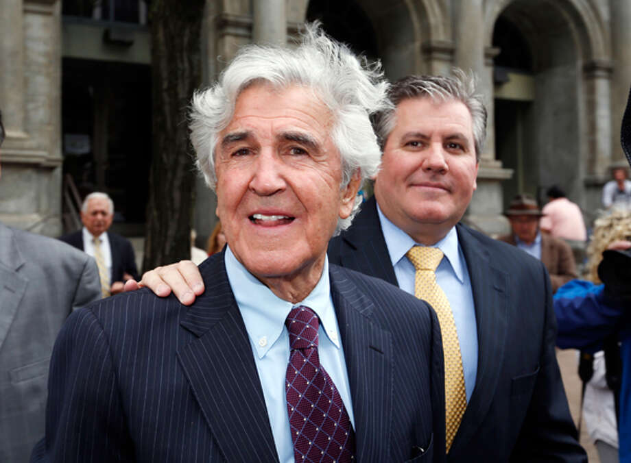 Former state Senator Joseph Bruno, left, and his son Ken Bruno walk away from the federal courthouse after a jury found him not guilty of federal fraud charges on Friday, May 16, 2014, in Albany. (AP Photo/Mike Groll) Photo: Mike Groll