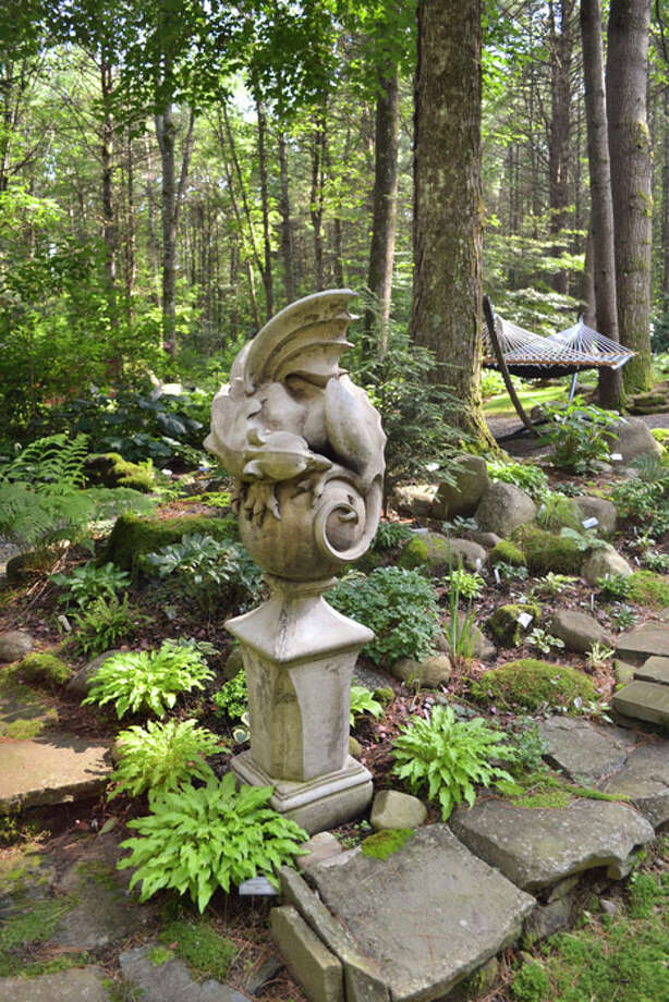 You'll find gargoyles and dragons throughout the garden, particularly in one area, the dragon-themed garden, which comprises hostas called the dragon lady and dragon tails. Photo: Emily Jahn / Emily Jahn/518Life magazine