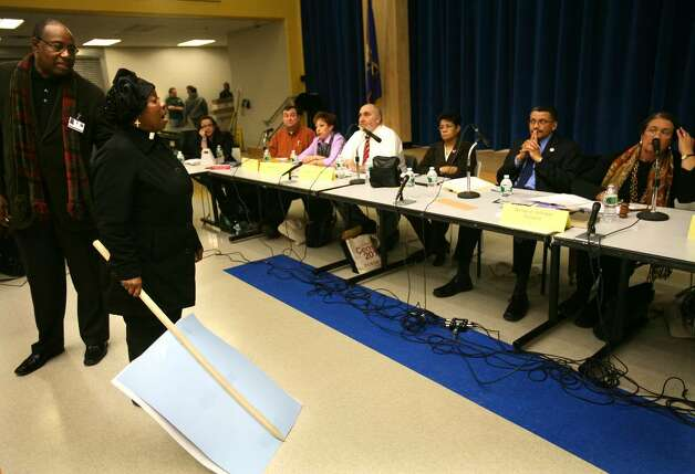 The Rev. Gerry Claytor confronts the Bridgeport Board of Education during their meeting at Geraldine Johnson School on Monday, February 8, 2010. Johnson was complaining that parents supporting the expansion of Black Rock School had been given a greater chance to speak than those opposing the expansion. Photo: Brian A. Pounds / Connecticut Post