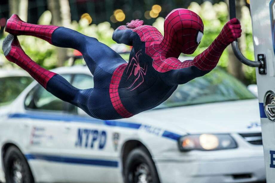 "Andrew Garfield stars as Spider-Man in Columbia Pictures' ""The Amazing Spider-Man 2,"" also starring Emma Stone. (Niko Tavernise / CTMG) ORG XMIT: Andrew Garfield (Pending) Photo: Niko Tavernise / ©2013 CTMG. All Rights Reserved. All Rights Reserved. **ALL IMAG"