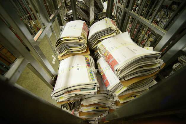 Bundles of weekend newspaper supplement sections are packaged and ready for delivery Thursday, May 15, 2014, at Times Union in Colonie, N.Y. (Will Waldron/Times Union) Photo: WW / 00026875A