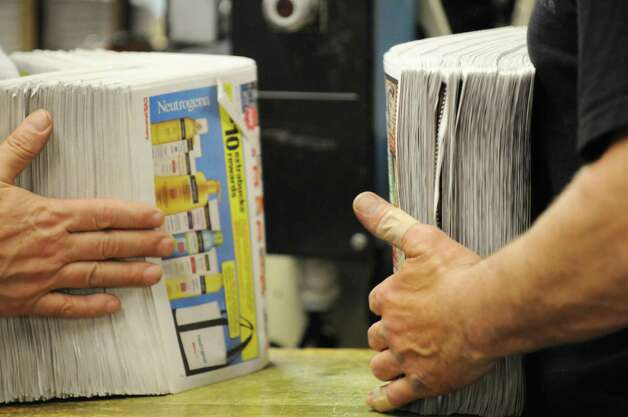 Coupons and ad materials are prepared for loading into inserter machines Thursday, May 15, 2014, at Times Union in Colonie, N.Y. (Will Waldron/Times Union) Photo: WW / 00026875A