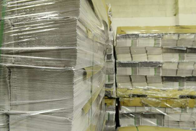 Stacks of coupon and ad materials are stored Thursday, May 15, 2014, at Times Union in Colonie, N.Y. (Will Waldron/Times Union) Photo: WW / 00026875A