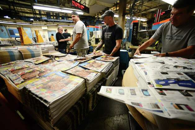 Ronald O'Brian, left, Robert Insero, Mike Mangini, John Dunham and Jack Lagitch, right, load coupon and ad materials into inserter machines Thursday, May 15, 2014, at Times Union in Colonie, N.Y. (Will Waldron/Times Union) Photo: WW / 00026875A