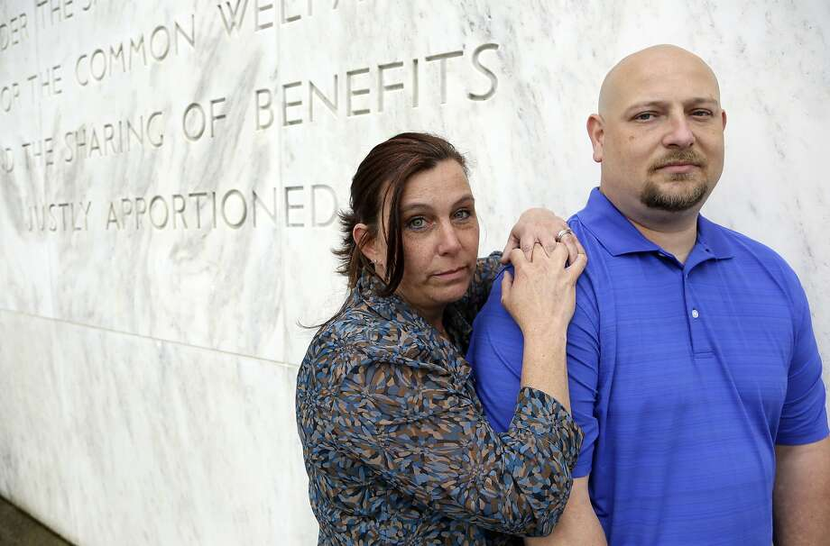 In this May 8, 2014 photo, former Spartanburg, S.C., sheriff's deputy Brandon Bentley, poses for a photo with his wife, retired Salem police department officer Kelly Clark, in front of the Capitol building in Salem, Ore.  Bentley's appeal to the South Carolina Supreme Court on a post-traumatic stress disorder claim was denied, stating the law did not provide mental health benefits for officers because they are trained in the use of deadly force and know that they may have to use it. (AP Photo/Don Ryan) Photo: Don Ryan, Associated Press
