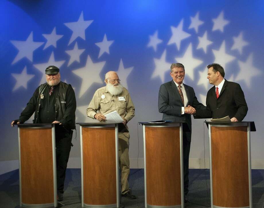 GOP candidates for governor Harley Brown (left) and Walt Bayes upstage Idaho Gov. Butch Otter and state Sen. Russ Fulcher with talk of Armageddon and motorcycle club bias. Photo: Jim Hadley, Associated Press