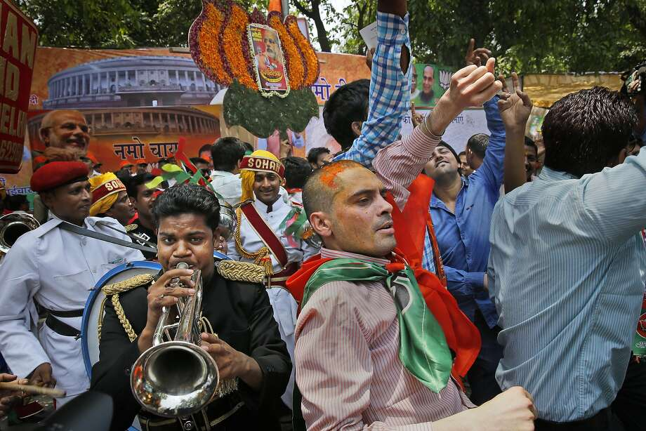 Bharatiya Janata Party supporters in New Delhi celebrate victory over the long-dominant ruling party. Photo: Manish Swarup, Associated Press