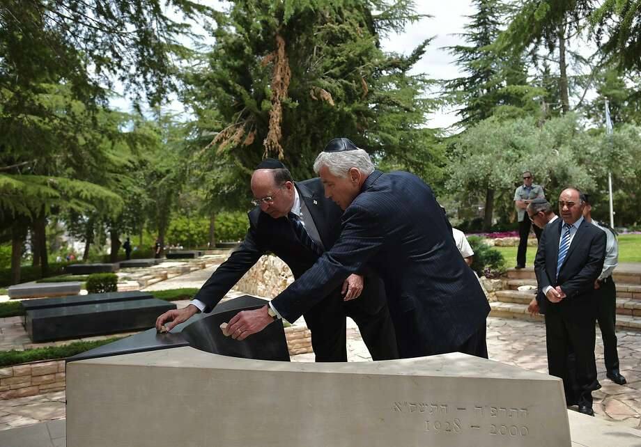 "U.S. Defense Secretary Chuck Hagel, right, and Israeli Defense Minister Moshe Yaalon place stones on the tomb of assassinated Israeli prime minister Yitzhak Rabin, as they visit the Mount Herzl national cemetery in Jerusalem on Friday, May 16, 2014. Hagel pledged to Israeli leaders Friday that the U.S. ""will do what we must"" to prevent the Jewish state's greatest fear of a nuclear-armed Iran. (AP Photo/Mandel Ngan, Pool) Photo: Mandel Ngan, Associated Press"