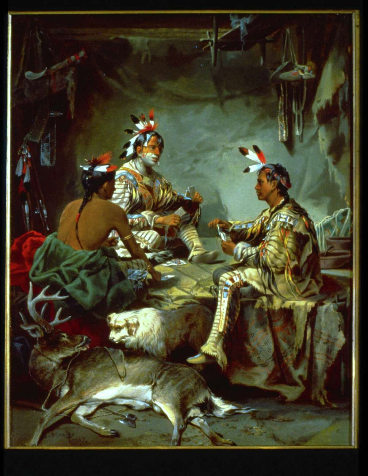 """John Mix Stanley's """"Gambling for the Buck,"""" in the permanent galleries at the Stark Museum of Art in Orange, idealizes Native Americans who probably would not have been dressed in tribal finery for a card game. (1867, oil on canvas)"""