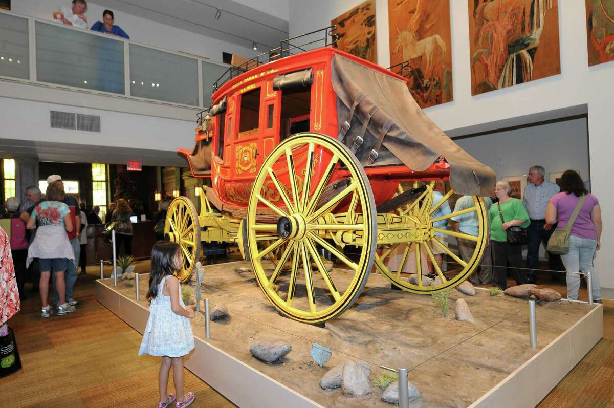 A reproduction of a Wells Fargo & Co. nine-passenger Western Mail stagecoach, purchased with funds provided by the Amy Shelton McNutt Charitable Trust and the Mark C. Lemons Foundation, is located on the first floor of the Briscoe Western Art Museum.