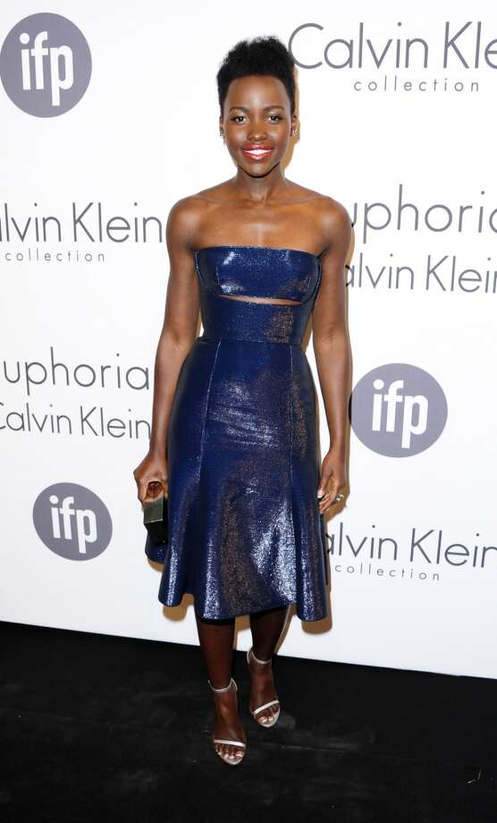 Lupita Nyong'o attends the IFP and Calvin Klein Women In Film Party at the 67th international film festival, Cannes, southern France, Thursday, May 15, 2014. Photo: Arthur Mola, Associated Press
