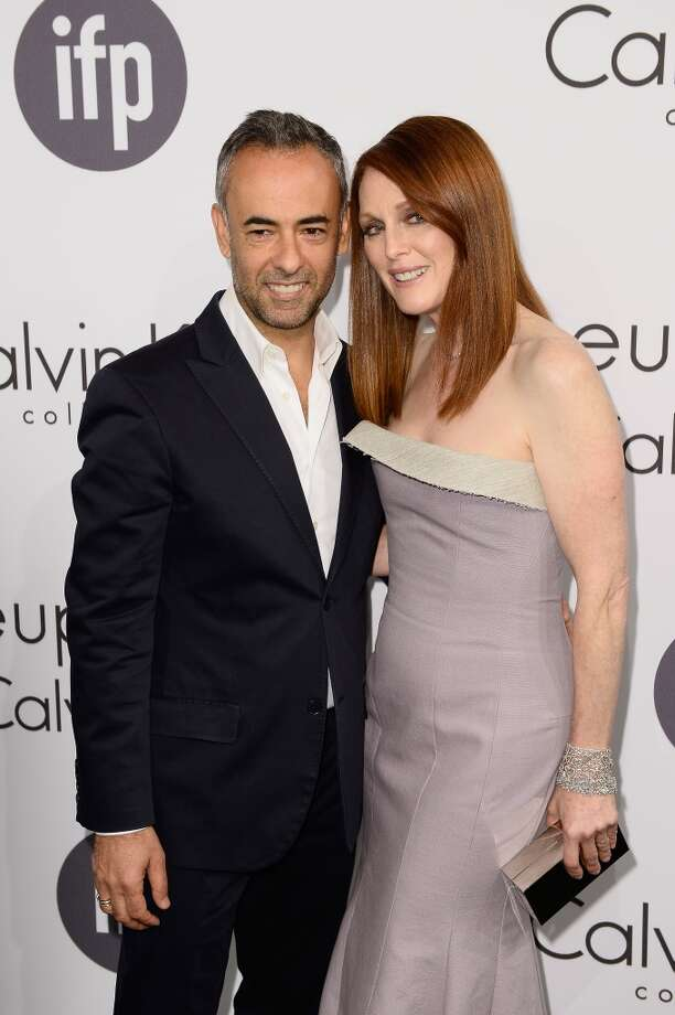 Designer Francisco Costa (L) and Actress Julianne Moore attend the Calvin Klein party during the 67th Annual Cannes Film Festival on May 15, 2014 in Cannes, France. Photo: Ian Gavan, Getty Images