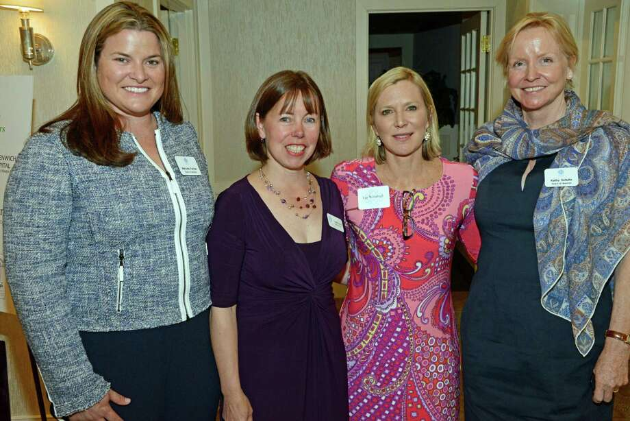 At the New Canaan Community Foundation's annual Touch A Life luncheon May 7 at the Country Club of New Canaan were, from left, Event co-chairman Marjorie Furman, NCCF Executive Director Cynthia Gorey, keynote speaker Lee Woodruff and event co-chairman Kathy Schulte. Photo: Contributed Photo, Contributed / New Canaan News Contributed