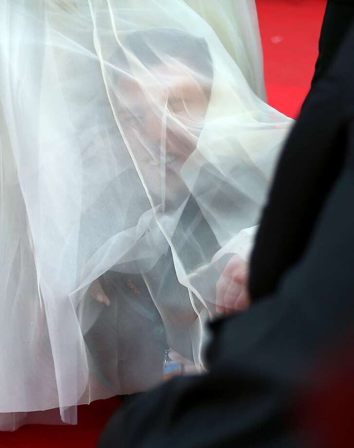 "A man sneaks under America Ferrera's dress at the ""How To Train Your Dragon 2"" premiere during the 67th Annual Cannes Film Festival on May 16, 2014 in Cannes, France.  Photo: Andreas Rentz, Getty Images"